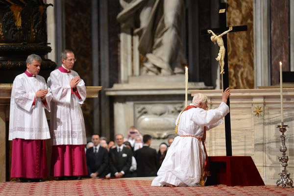 Pope venerates the Cross (http://www.sun-sentinel.com/features/sfl-popopell,0,3210176.photo)